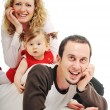 Happy young family together in studio — Stock Photo