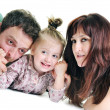 Happy young family together in studio — Stock Photo #5384194