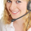 Business blonde woman with headset — Stock Photo