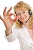 Blonde geschäftsfrau mit headset — Stockfoto