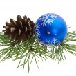 Christmas ball and pine cone — Stock Photo
