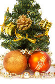 Christmas decorations and fir tree — Stock Photo