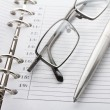 Notebook, pen and glasses — Stock Photo