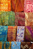 Assortment of colorful sarongs for sale — Stock Photo