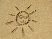 Sun drawing on the sand — Stock Photo