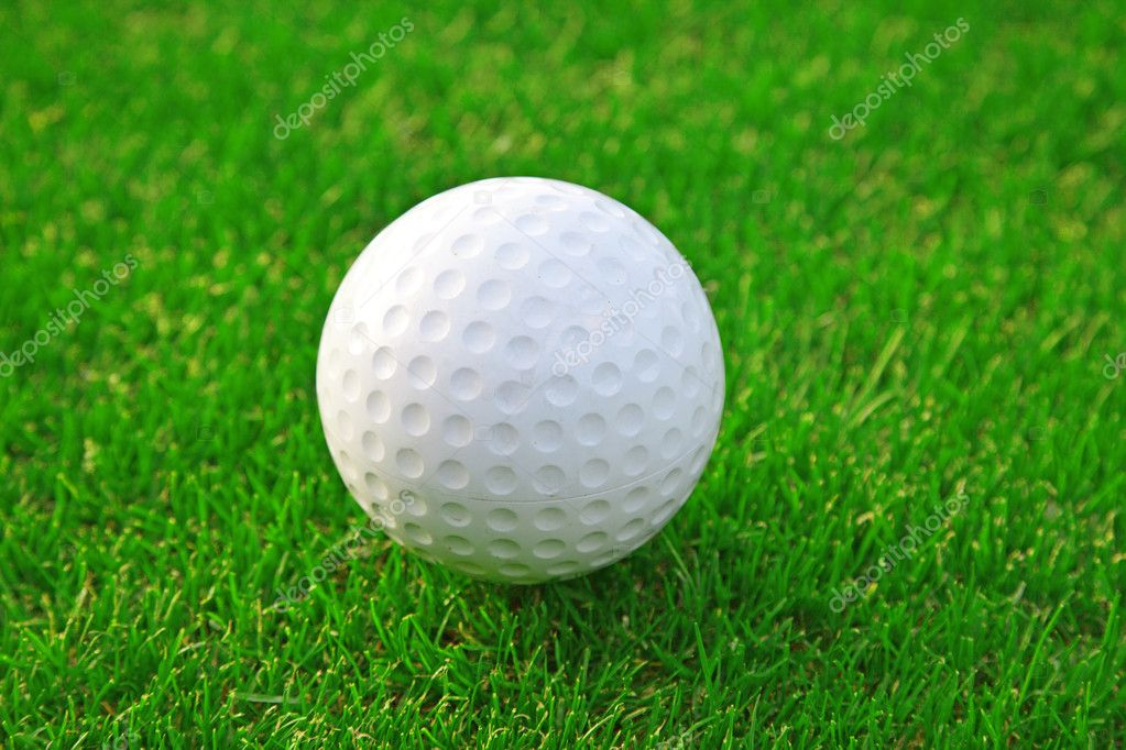 Golf ball on the green grass  Stock Photo #4926278