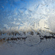 Stock Photo: Snow pattern on winter window