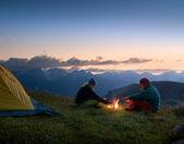 Couple camping at night — Stock Photo