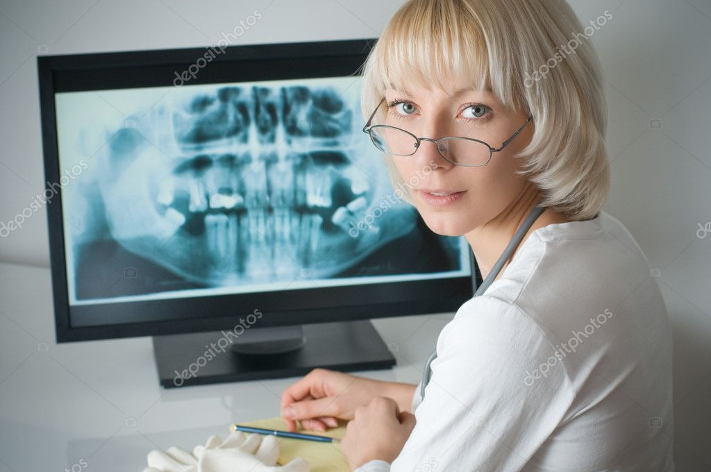 Doctor looking at x-ray on computer  Stock Photo #5208319