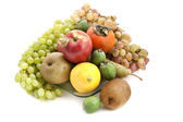 A lot of ripe fruit on a glass plate — Stock Photo