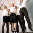 Group of employees jumping — Stock Photo