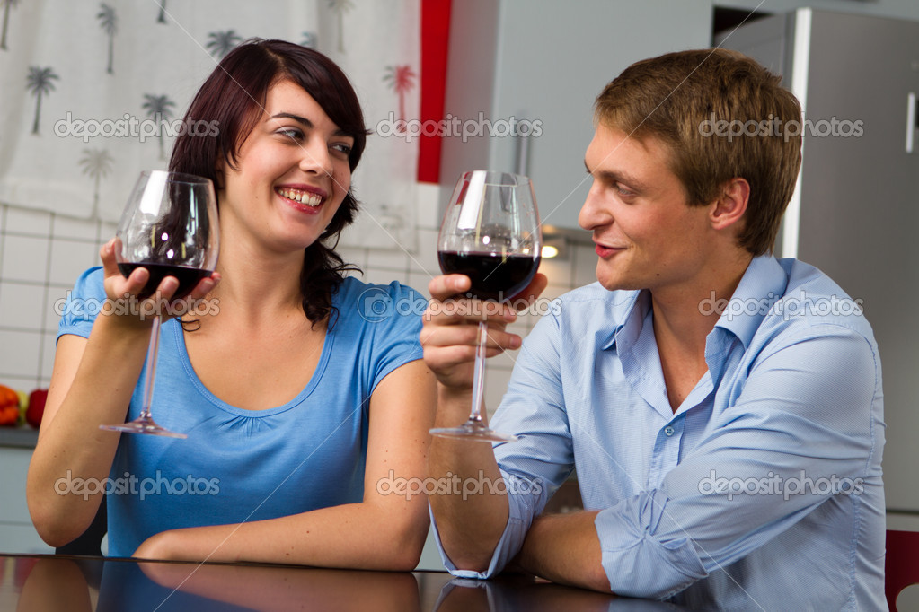 Happy young couple toasting wine together - celebrating — Stock Photo #4895836