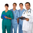 Royalty-Free Stock Photo: Portrait of doctor with three practitioners in the background