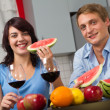 Young couple drink red wine and eat watermelon — Stock fotografie