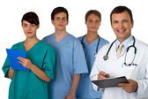 Portrait of doctor with three practitioners in the background — Stock Photo