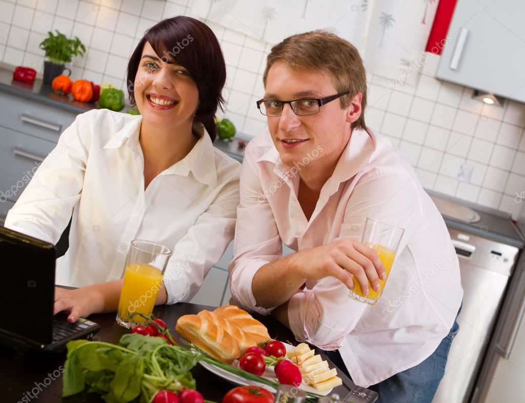 Happy young couple in their kitchen  — Stock Photo #4909222