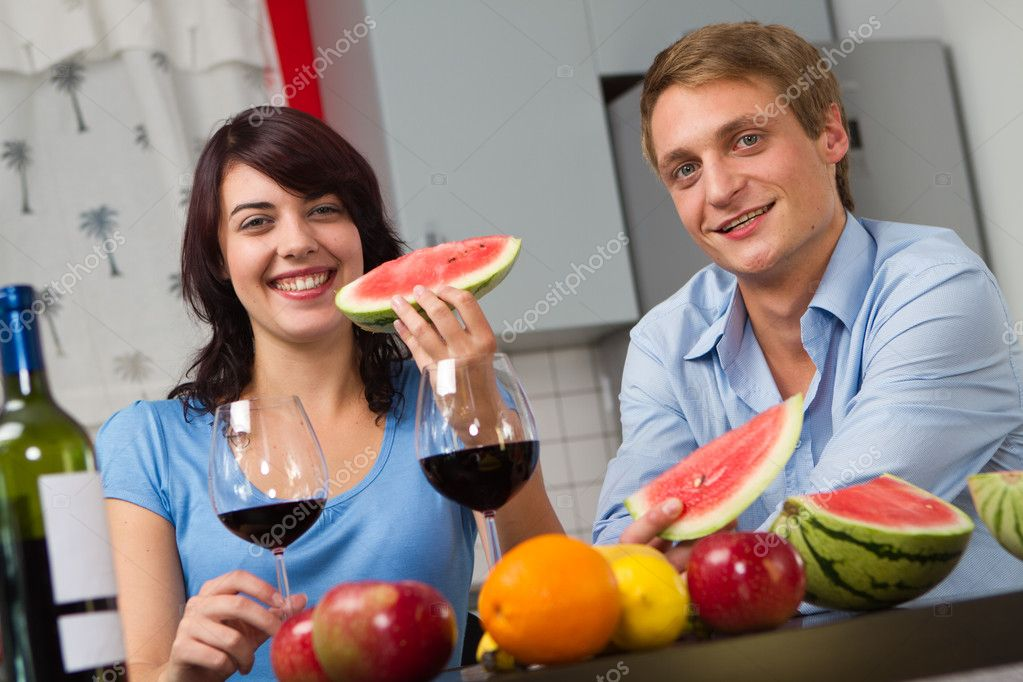 Happy young couple drink red wine and eat watermelon  Stock Photo #4909227