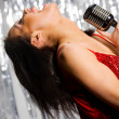 Stock Photo: Singing woman