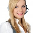 Customer Representative with headset smiling during a telephone — Stock Photo
