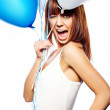 Smiling woman holding ballons - Stock Photo