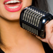 Woman with microphone — Stock Photo #4169320