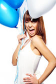Smiling woman holding ballons — Stock Photo