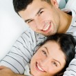 Cute lovers having fun together in the living-room at home - Stock Photo