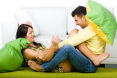 Young happy couple having a fun at home — Stock Photo