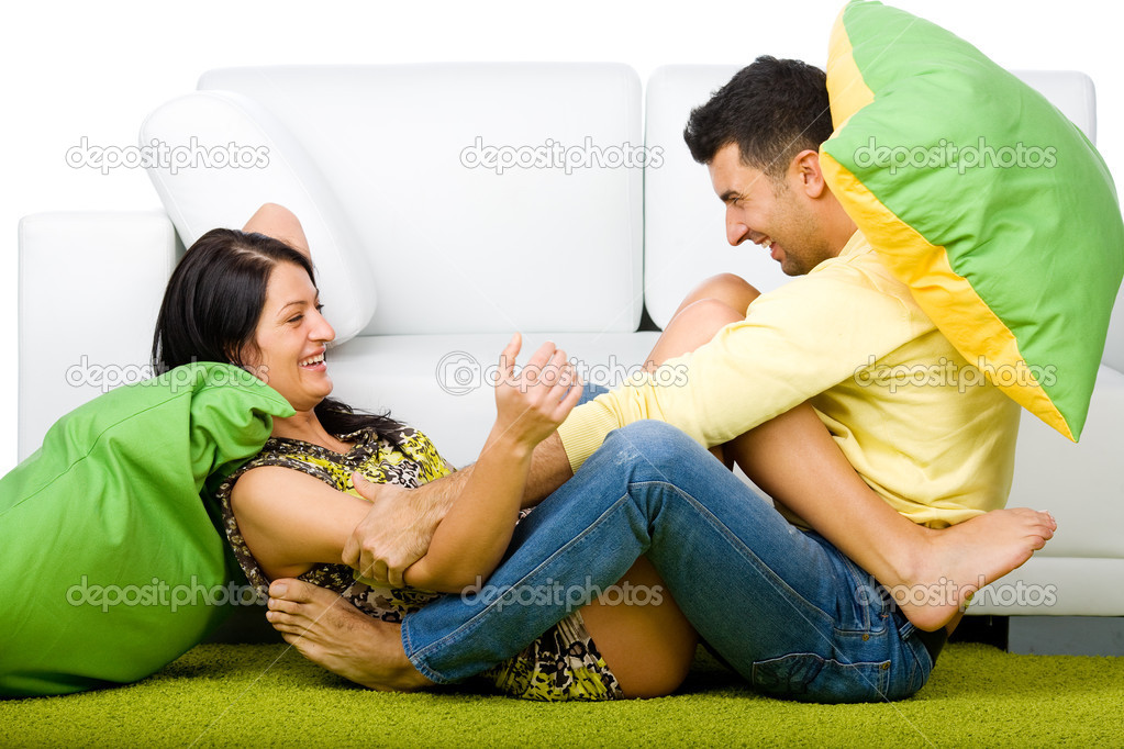 Young happy couple having a fun at home — Stock Photo #4172548