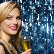 Sexy woman with glass of champagne — Stock Photo