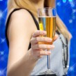 Woman holding glass of champagne — Stock Photo