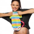 Woman holding baby clothes — Stock Photo #4321303