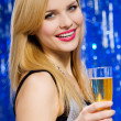 Stock Photo: Smiling woman with glass of champagne
