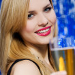 Smiling woman with glass of champagne — Stock Photo