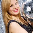 Stock Photo: Sexy woman dancing on silver background