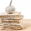 Garlic on matzo stack — Stock Photo