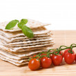 Matzo with tomato and basil — Stock Photo