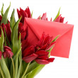 Red tulips and red envelope — Stok fotoğraf