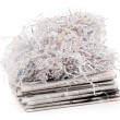 Paper shred on newspaper — Stock Photo
