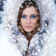 Beautiful young womin winter fur coat — Stock Photo #4276593
