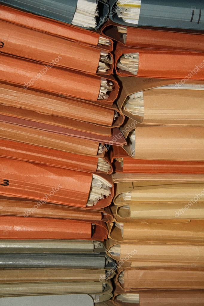Stack of cardboard dossiers in many different colors   Stock Photo #4556023