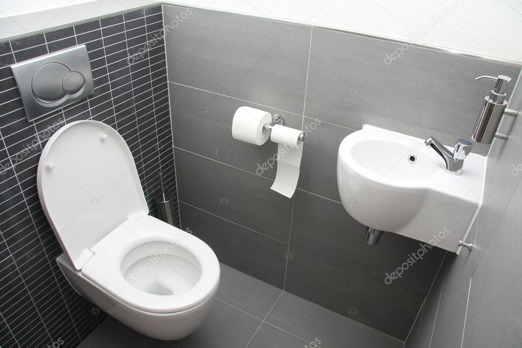 A modern toilet in different shades of grey — Stock Photo #4585431