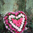 Heartshaped flower arrangement — Stock Photo
