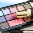 Stock Photo: Eye shadow palet with lipstick and brush