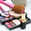 Pink lipstick and make up palet — Stock Photo