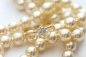 Solitaire diamond ring on pearls — Stock Photo
