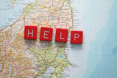 Help Japan - hit by Tsunami — Stock Photo