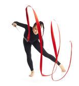 Gymnastic with ribbon posing on white — Stock Photo