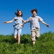 Girl and boy running outdoor — Stock Photo #4643323