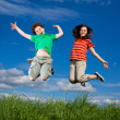 Girl and boy jumping — Stock Photo #4643331